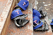 MINNEAPOLIS, MN - APRIL 15: General view of Texas Rangers caps and gloves on the dugout steps during the game against the Minnesota Twins at Target Field on April 15, 2012 in Minneapolis, Minnesota. (Photo by Joe Robbins)