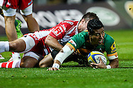 George Pisi of Northampton Saints (right) goes to ground during the Aviva Premiership match at Franklin's Gardens, Northampton<br /> Picture by Andy Kearns/Focus Images Ltd 0781 864 4264<br /> 05/09/2014