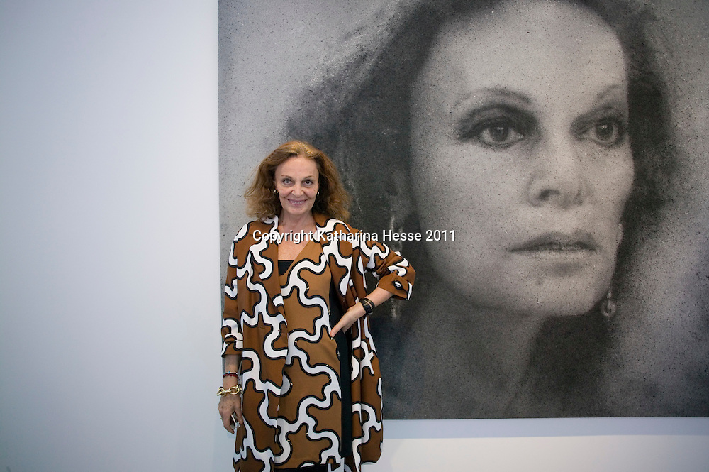 Beijing, April,2, 2011 : Diane von Furstenberg  poses for a portrait in front of an art work by Zhang Huan .