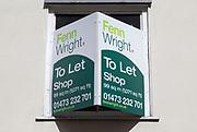 Shop to Let estate agent sign Fenn Wright estate agents, Ipswich, Suffolk, England, UK