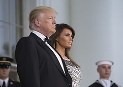 April 24, 2018 - Washington, District of Columbia, U.S. - United States President Donald J. Trump and first lady Melania Trump welcome President Emmanuel Macron and Mrs. Brigitte Macron of France for the State Dinner during a visit to The White House in Washington. (Credit Image: © Chris Kleponis/CNP via ZUMA Wire)