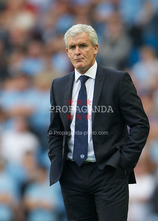 MANCHESTER, ENGLAND - Saturday, September 1, 2012: Queens Park Rangers' manager Mark Hughes during the Premiership match against Manchester City at the City of Manchester Stadium. (Pic by David Rawcliffe/Propaganda)