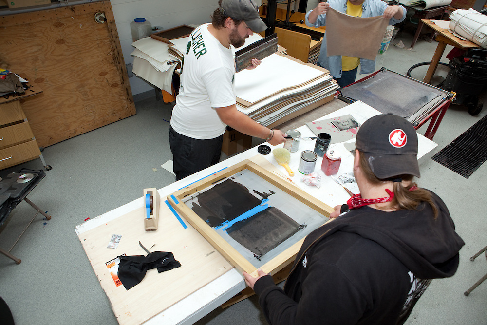 Nathan Toth (left) Christina Taber (center) and Todd Dennis (right). Combat Paper participants in a workshop in the Paper Lab in the Department of Art at the University of Wisconsin-Madison.