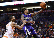 Nov 20, 2013; Phoenix, AZ, USA; Sacramento Kings guard Isaiah Thomas (22) lays up the ball against the Phoenix Suns forward Marcus Morris (15) in the first half at US Airways Center. Mandatory Credit: Jennifer Stewart-USA TODAY Sports