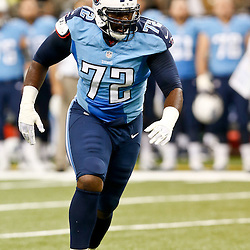 Aug 15, 2014; New Orleans, LA, USA; Tennessee Titans offensive tackle Michael Oher (72) during first half of a preseason game against the New Orleans Saints at Mercedes-Benz Superdome. Mandatory Credit: Derick E. Hingle-USA TODAY Sports