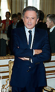 """Michel Drucker  at the ceremony who he was awarded at  the title of Commander of the Order of the Crowne at the Palace Egmont"""" at Brussels, 2014 in Brussels, Belgium."""