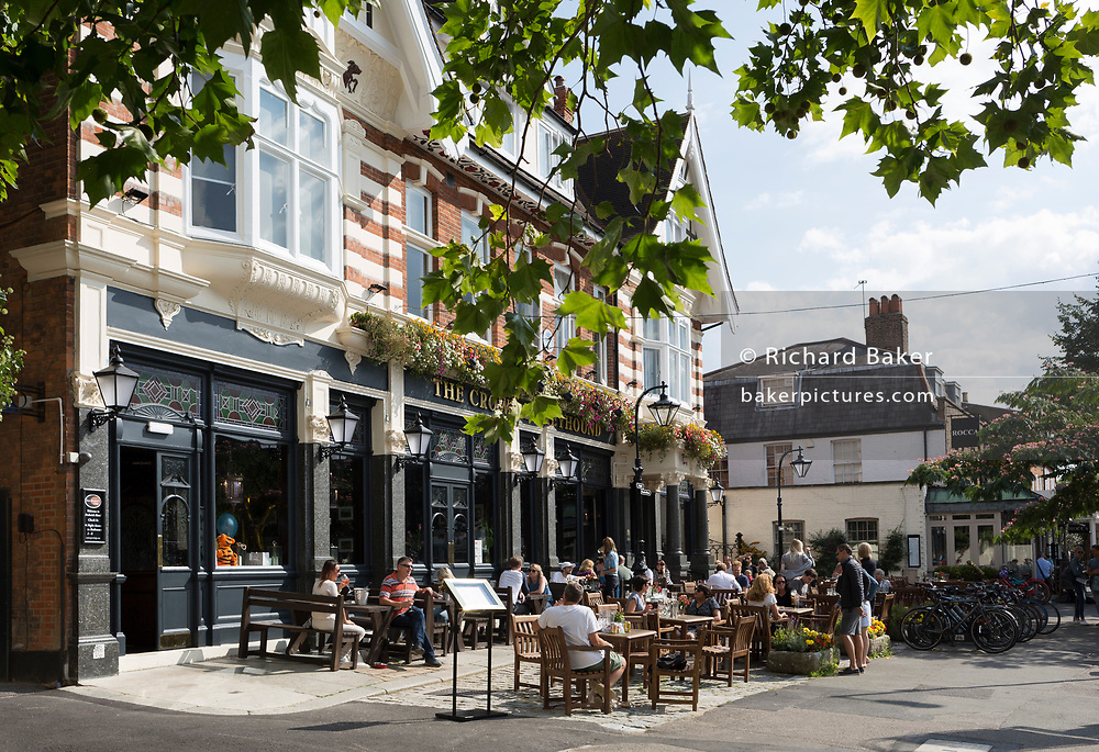Summer drinkers enjoy a warm Sunday afternoon outside the newly refurbished Crown and Greyhound pub in Dulwich Village, on 2nd September 2017, in south London, England.