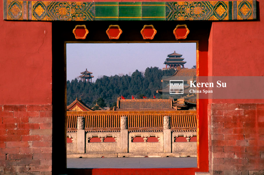 View of the traditional architecture through the gate in the Forbidden City, Beijing, China