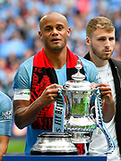 Vincent Kompany (4) of Manchester City with the FA Cup during the The FA Cup Final match between Manchester City and Watford at Wembley Stadium, London, England on 18 May 2019.