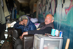 © Licensed to London News Pictures . 30/04/2017 . Salford, UK . Valeriy (43) (r) , from Lithuania . Homeless men are living in a towpath tunnel in Saford , in the shadow of the Ordsall Chord railway link and a large , Chinese-backed housing development. Photo credit : Joel Goodman/LNP