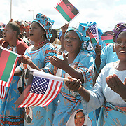 July 14, 2006 - Malawian singers prepare to greet President Bill Clinton on his arrival to Malawi. Clinton met with Malawi's President, Bingu Wa Mutharika, and signed an agreement to launch the Clinton Hunter Development Initiative. Photo by Evelyn Hockstein