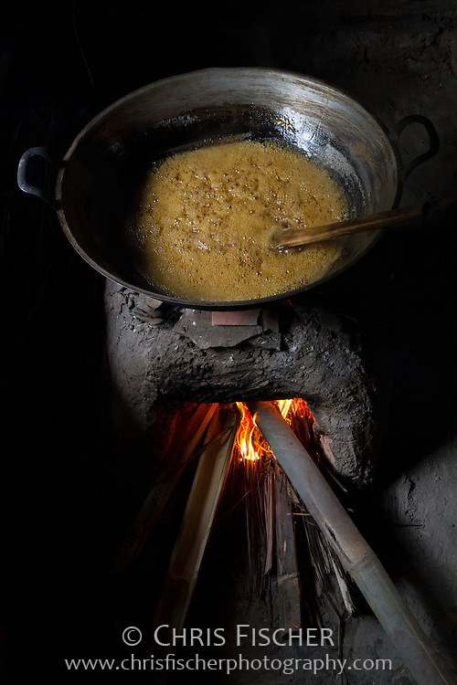 Traditional Javanese process for making brown sugar in a rural village in West Java, Indonesia. The ingredients for brown sugar are boiled until the mixture thickens.