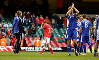 Photo: Leigh Quinnell.<br /> Wales v Slovakia. UEFA European Championships 2008 Qualifying. 07/10/2006. Wales captain Craig Bellamy walks off unhappy after the defeat by Slovakia.