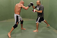 Randy Couture (left) and Gil Martinez do boxing padwork during a training session ahead of UFC 105 at Straight Blast Gym in Manchester, England on November 11, 2009.