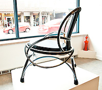 Untitled prototype side/lounge chair made from chromed steel bicycle rims, with a padded vinyl seat and inner-tube back.