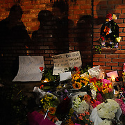Mourning fans gather,  leaving flowers and momentos, at the gate of the Jackson family home in Encino, California, on June 25, 2009, on the night of the death of pop superstar Michael Jackson. Photo by Jen Klewitz