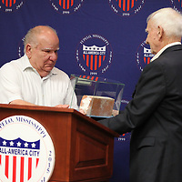 "Tony Lute, left, accepts a brick from the ""Hanoi Hilton"" from Ret. Col. ""Smitty"" Harris that Lute will on display at the Tupelo Veterans Museum."