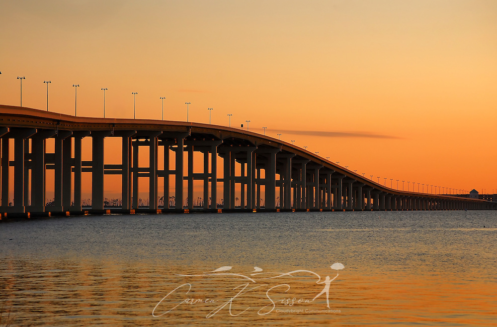 The sun sets on the Biloxi Bay Bridge, viewed from Front Beach in Ocean Springs, Mississippi, on Dec. 18, 2010. The bridge, part of U.S. Highway 90, connects the cities of Ocean Springs and Biloxi. The original bridge was damaged by Hurricane Katrina in August 2005. The new bridge spans six lanes and includes a pedestrian walkway. (Photo by Carmen K. Sisson/Cloudybright)