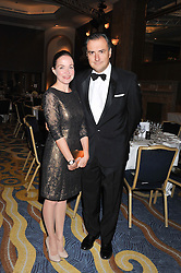 LOUISA McCARTHY and DOMINIC McCARTHY at the 20th CEW (UK) Achiever Awards 2012 - celebrating two decades of women, passion, beauty, held at the Hilton, park Lane, London on 16th October 2012.