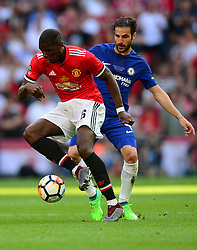 Paul Pogba of Manchester United battles for the ball with Cesc Fabregas of Chelsea - Mandatory by-line: Alex James/JMP - 19/05/2018 - FOOTBALL - Wembley Stadium - London, England - Chelsea v Manchester United - Emirates FA Cup Final