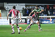 George Francomb of AFC Wimbledon is blocked out during the Sky Bet League 2 match between Exeter City and AFC Wimbledon at St James' Park, Exeter, England on 28 December 2015. Photo by Stuart Butcher.