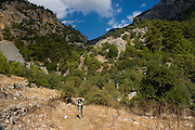Turkey, Antalya Province, Olympos National Park female hiker - Model Release Available