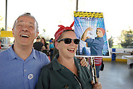 Windsor, Canada. 01 May 2015. -- Frank Favot, an organiser, poses with Patricia Fell, an artist dressed as Rosie the Riveter, at the Festival of Bread and Roses.   -- MayWorks Windsor 2015, a festival for workers and social justice art opens on May Day, International Workers's Day, with a Bread and Roses festival, Detournements exhibition opening and a Windsor Feminist Theatre fundraiser.