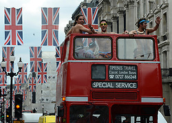 © Licensed to London News Pictures. 30/05/2012. London, UK An open top Route Master London red bus with men wearing underwear makes its way down Regents Street with Union Flag bunting across the street. Preparations today 20th May 2012 around London ahead of The Queen's Diamond Jubilee this weekend. Photo credit : Stephen Simpson/LNP