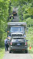July 13, 2017 - Solebury Township, Bucks County, Pennsylvania, U.S.- Police and other crews work at the entrance of a crime scene off of Lower York Road. A Pennsylvania man under suspicion for his connection to the disappearance of four men who disappeared in rural Pennsylvania last weekend has confessed to their murders. (Credit Image: © Harry Fisher/TNS via ZUMA Wire)