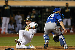OAKLAND, CA - JULY 15:  Stephen Vogt #21 of the Oakland Athletics scores a run past Russell Martin #55 of the Toronto Blue Jays during the fourth inning at the Oakland Coliseum on July 15, 2016 in Oakland, California. (Photo by Jason O. Watson/Getty Images) *** Local Caption *** Stephen Vogt; Russell Martin