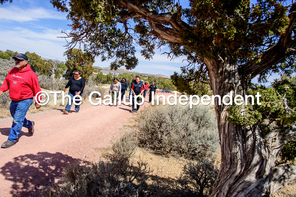"""The University of New Mexico-Gallup  faculty and staff take to the campus trail for """"Walking out on Work"""" to support the American Heart Association's National Walking Day in Gallup April 4."""