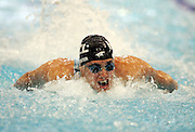 Moss Burmester competes in the Men's 50m Butterfly semi final at the at the New Zealand Swimming World Championship Trials at the West Aquatic Centre, Auckland, New Zealand, on Thursday 14 December 2006. Photo: Hannah Johnston/PHOTOSPORT<br /><br /><br />141206
