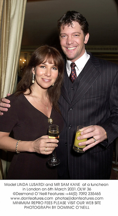 Model LINDA LUSARDI and MR SAM KANE  at a luncheon in London on 6th March 2001.OLW 36