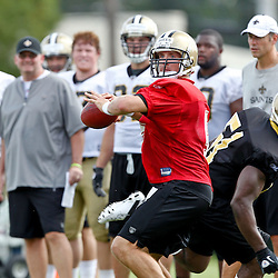 July 29, 2011; Metairie, LA, USA; New Orleans Saints quarterback Drew Brees (9) throws as he is pressured by linebacker Jonathan Vilma (51) during the first day of training camp at the New Orleans Saints practice facility. Mandatory Credit: Derick E. Hingle