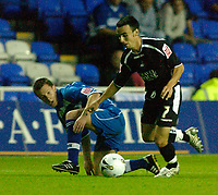 Photo: Daniel Hambury.<br /> Reading v Swansea. Carling Cup.<br /> 23/08/2005.<br /> Reading's Nicky Shorey and Swansea's Leon Britton.