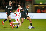 Barnsley forward Victor Adeboyejo (29) is tackled by Herbie Kane of Doncaster Rovers  during the EFL Sky Bet League 1 match between Doncaster Rovers and Barnsley at the Keepmoat Stadium, Doncaster, England on 15 March 2019.