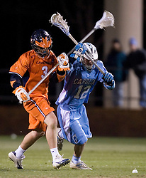 Virginia Cavaliers D Ricky Smith (3) and North Carolina Tar Heels Brian Connors (12) battle for a loose ball.  The Virginia Cavaliers Men's Lacrosse Team defeated the North Carolina Tar Heels 10-9 in overtime at Klockner Stadium in Charlottesville, VA on April 7, 2007.