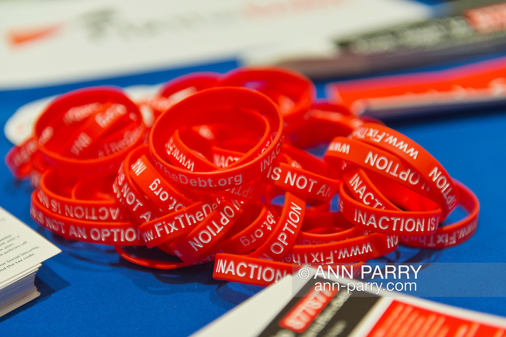 "Oct. 15, 2012 - Hempstead, New York, U.S. - Fix the Debt Campaign literature, rubber bracelets, and more are on table in lobby of Hofstra University's John Cranford Adams Playouse, while the campaign's co-founders, Simpson and Bowles, speak in the auditorium about ?America's Debt and Deficit Crisis: Issues and Solutions.? This event with the co-chairmen of the National Commission on Fiscal Responsibility and Reform, and co-leaders of Simpson-Bowles non-partisan U.S. fiscal debt reduction plan, was part of ""Debate 2012 Pride Politics and Policy"" a series of events leading up to when Hofstra hosts the 2nd Presidential Debate between Obama and M. Romney, the next night, October 16, 2012, in a Town Meeting format."