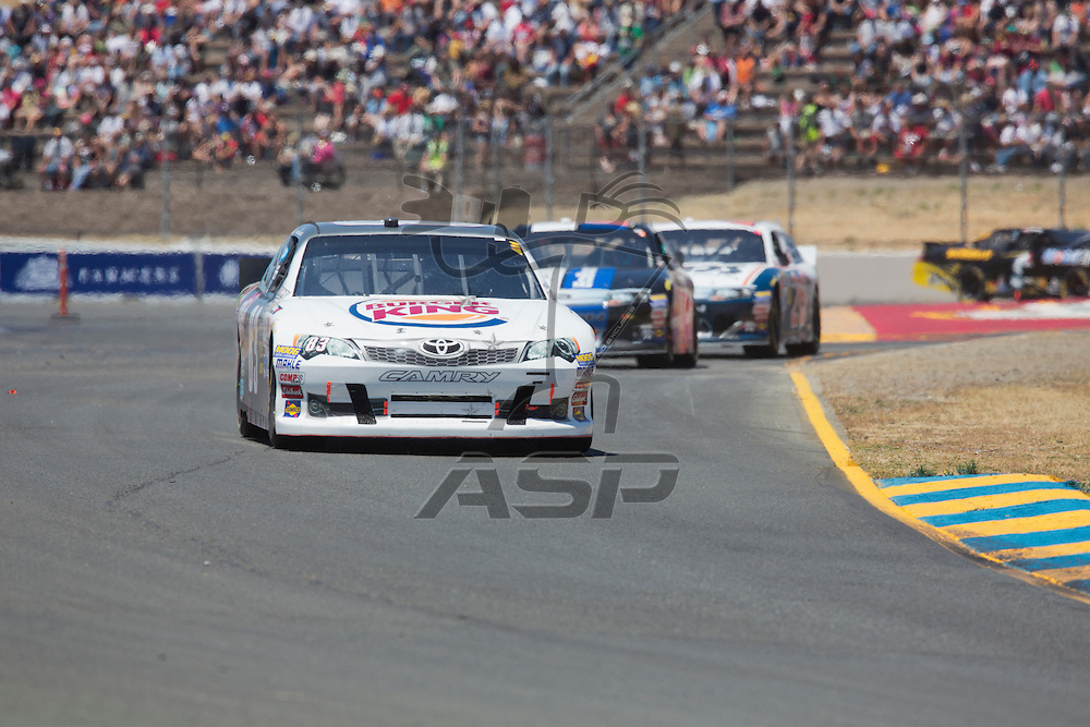 SONOMA, CA - JUN 24, 2012:  Landon Cassill (83) brings his car through the turns during the Toyota Save Mart 350 at the Raceway at Sonoma in Sonoma, CA.