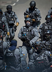 © Licensed to London News Pictures. 30/06/2015. London, UK. Armed police on the scene. Members of the emergency service take part in a mocked-up terrorist firearms attack at Aldwych station in central London. The exercise is the biggest to take place in London and is happening a week after dozens of people where killed when a gunman opened fire on a beach in Tunisia.  Photo credit: Ben Cawthra/LNP