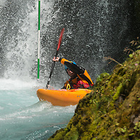 A kayaker paddles bellow Spirit Falls during the Slalom event of the the Little White Salmon Race Sunday. May 26, 2013 on the Little White Salmon River.