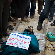 August 09, 2012 - Marea, Aleppo, Syria: Family members and friends gather around Housin Al Ali, a 28 year old Free Syria Army fighter killed in combat in Alepo's Salehedine neighborhood...The Syrian army and the FSA have in the past week exchanged heavy fire in a battle for the control of Syria's economic capital, Aleppo. (Paulo Nunes dos Santos/Polaris)