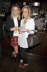 Left to right, SUSANNA WARREN and EVY LANGTON at the opening of The Cadogan Arms, 298 Kings Road, London on 28th May 2009.