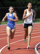 Valley Central's Holly Cavalluzzo and Newburgh Free Academy's Gianna Frontera lead the 3,000-meter run during the Section 9 track and field state qualifying meet in Middletown on Thursday, May 30, 2013. Cavalluzzo won the race.