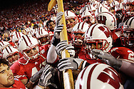 Wisconsin Badgers players celebrate after reclaiming the Paul Bunyan axe after defeating Minnesota 38-14 at Camp Randall Stadium in Madison, Wisconsin..