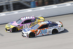 August 12, 2018 - Brooklyn, Michigan, United States of America - Landon Cassill (00) and David Ragan (38) battle for position during the Consumers Energy 400 at Michigan International Speedway in Brooklyn, Michigan. (Credit Image: © Chris Owens Asp Inc/ASP via ZUMA Wire)
