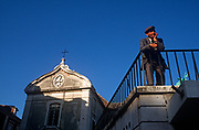 An elderly 1990s man looks out over his city, alongside a church, on 21st March 1994, in Lisbon, Portugal. (Photo by Richard Baker / In Pictures via Getty Images)