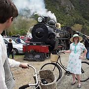 Aleisha Todd, 23, and Kerry Guyton, 26,  with the Kingston Flyer vintage steam train at Saturday's relaunch of the historic locomotives at Fairlight near Queenstown, Central Otago, New Zealand, 29th October 2011. Photo Tim Clayton...
