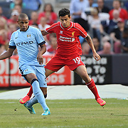 Fernando, (left), Manchester City, is challenged by Philippe Coutinho, Liverpool, during the Manchester City Vs Liverpool FC Guinness International Champions Cup match at Yankee Stadium, The Bronx, New York, USA. 30th July 2014. Photo Tim Clayton