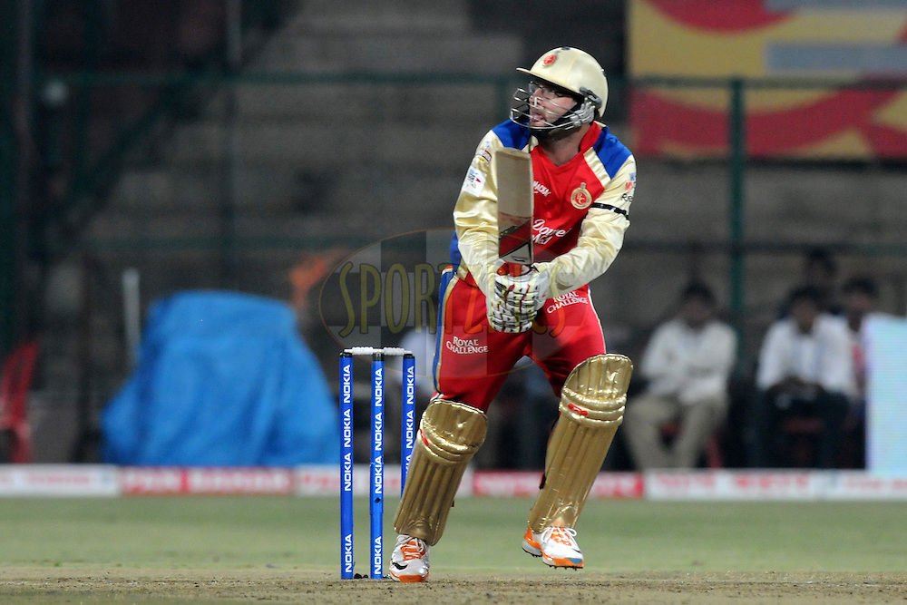 Daniel Vettori of Royal Challengers Bangalore bats during match 1 of the NOKIA Champions League T20 ( CLT20 )between the Royal Challengers Bangalore and the Warriors held at the  M.Chinnaswamy Stadium in Bangalore , Karnataka, India on the 23rd September 2011..Photo by Pal Pillai/BCCI/SPORTZPICS